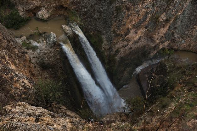 High angle view of waterfall in forest, tahana waterfall, nahal ayoun nature reserve, metula, northe Premium Photo