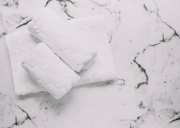 High angle view of white napkins on marble background Free Photo