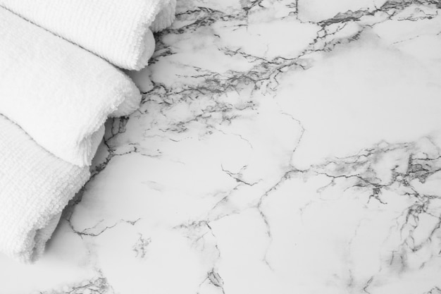 High angle view of white towels on marble backdrop Free Photo