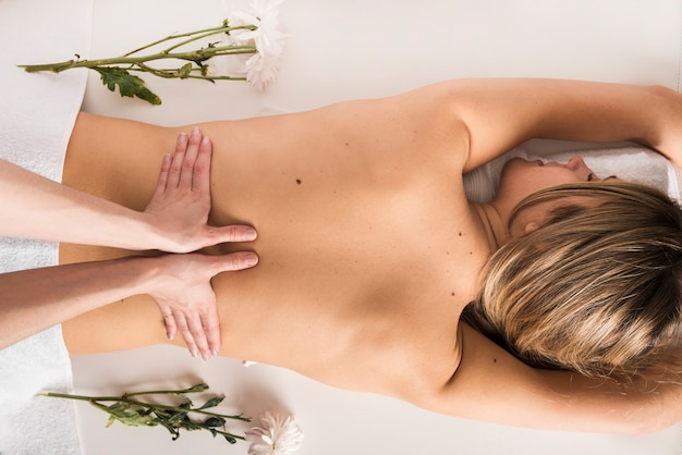High angle view of a woman receiving back massage from therapist Free Photo