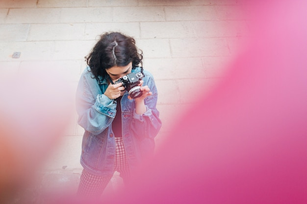 High angle view of woman taking photo with camera Free Photo