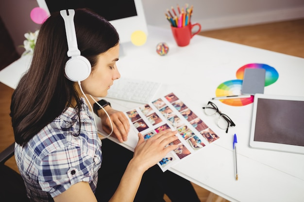 High angle view of woman viewing photographs Premium Photo