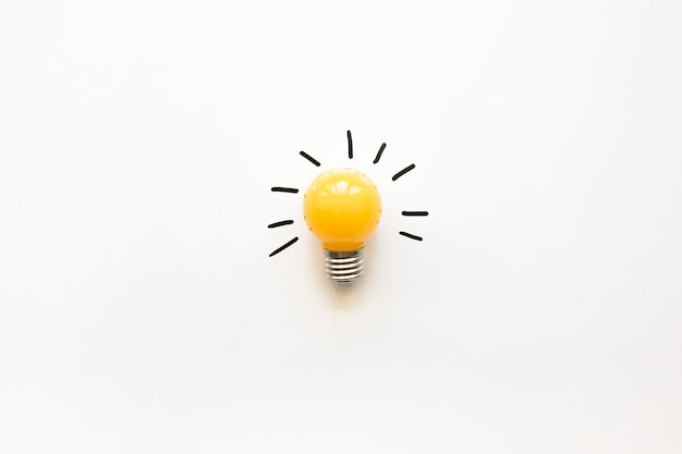 High angle view of yellow electric bulb on white background Free Photo