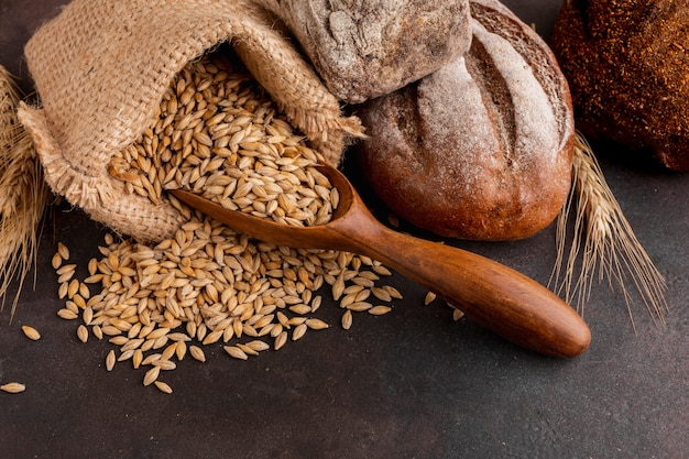 High angle of wheat seeds in jute bag Free Photo