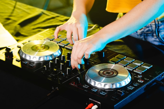 High angle woman as dj mixing and entertaining Free Photo