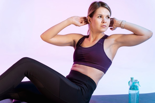 High angle woman doing abdominal exercise Free Photo