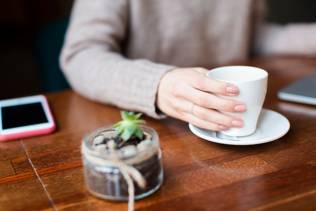 High angle woman drinking coffee Free Photo