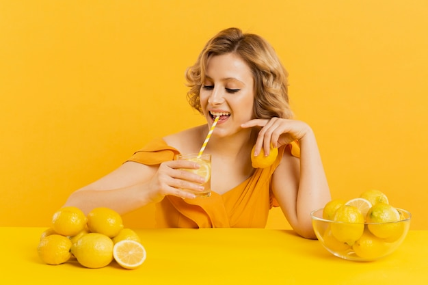 High angle woman drinking lemonade Free Photo