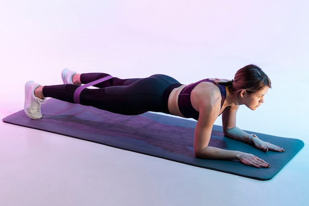 High angle woman exercising on mat Free Photo
