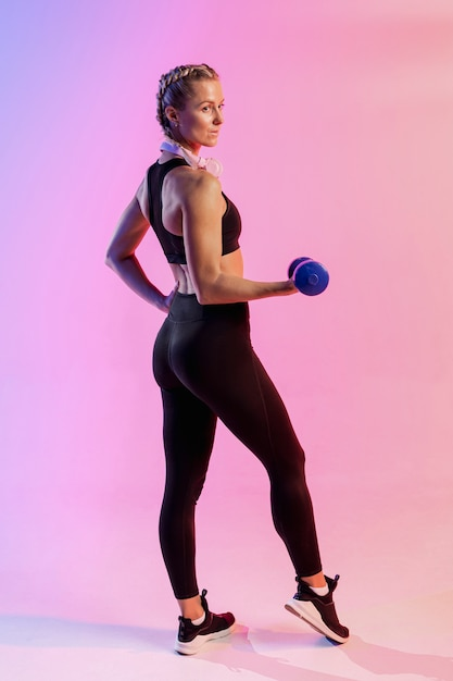 High angle woman exercising with weights Free Photo