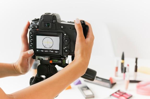High angle woman setting camera to record Free Photo
