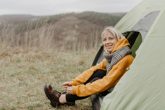 High angle woman sitting in tent Free Photo