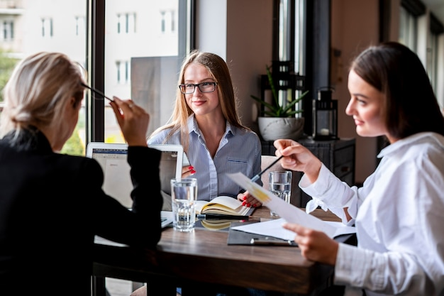 High angle women at office planning together Free Photo