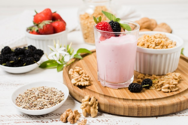 High angle of yoghurt glass with fruits Free Photo
