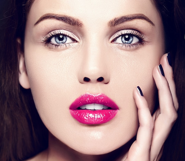 High fashion look.glamor closeup beauty portrait of beautiful   caucasian young woman model with nude makeup   with perfect clean skin with colorful pink lips Free Photo