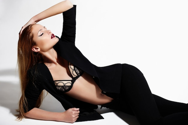 High fashion look.glamor portrait of beautiful sexy stylish caucasian young woman model in black cloth with bright makeup Free Photo