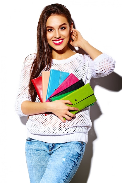 High fashion look.glamor stylish sexy smiling beautiful young woman model in summer bright white casual  hipster cloth with colorful clutch  purse Free Photo