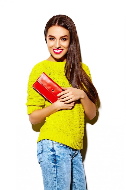 High fashion look.glamor stylish sexy smiling beautiful young woman model in summer bright yellow casual  hipster cloth with clutch  purse Free Photo