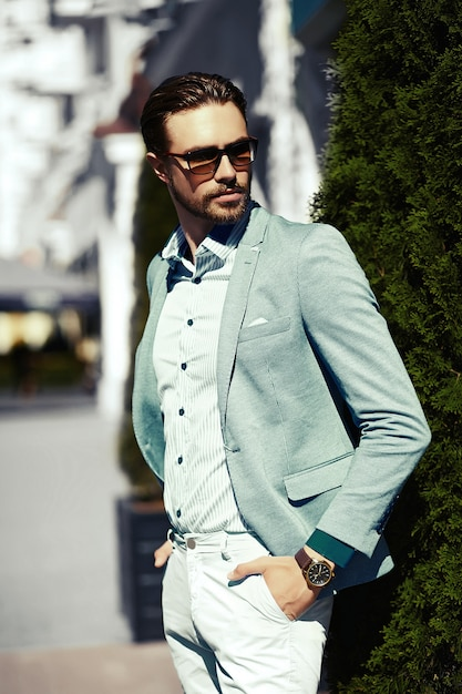 High fashion look.young stylish confident happy handsome businessman model  in suit cloth lifestyle in the street in sunglasses Free Photo