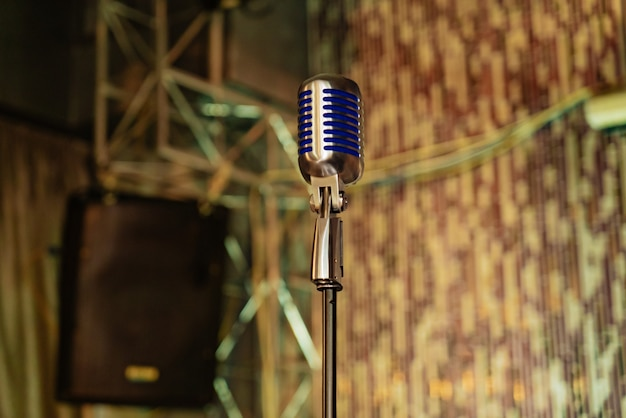 High microphone with blue inserts is in the centre of room Premium Photo