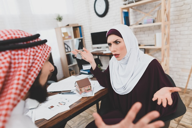 High mortgage arabic family quarreling in office Premium Photo