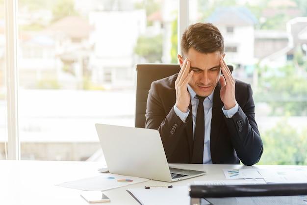 High pressure of businessman in office. seriously work, headache. Premium Photo