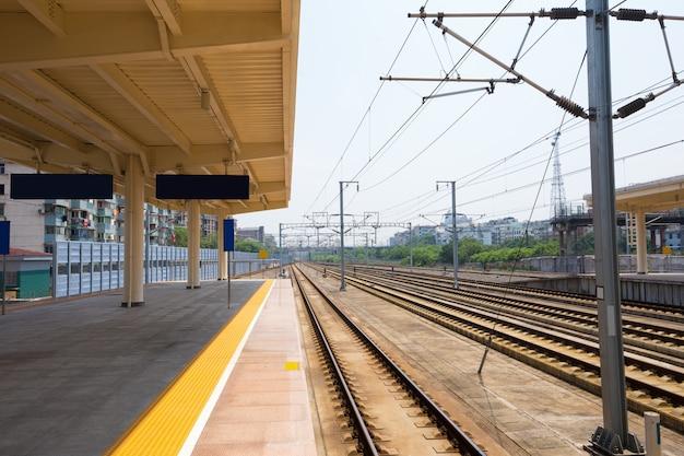 High speed passenger train on tracks with motion blur effect at sunset. railway station in ukraine Premium Photo