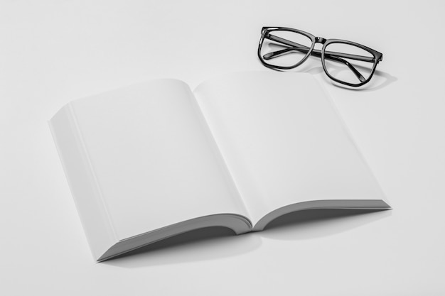 High view copy space book with shadow and glasses Premium Photo