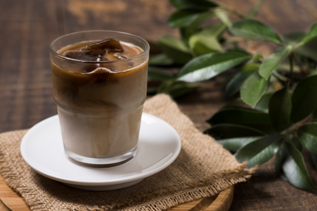 High view delicious coffee in cup with cloth Free Photo