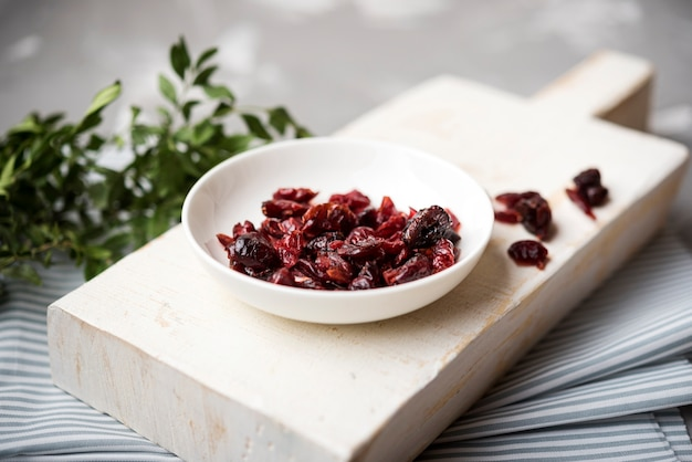 High view dried fruit on wooden board with blurred background Free Photo