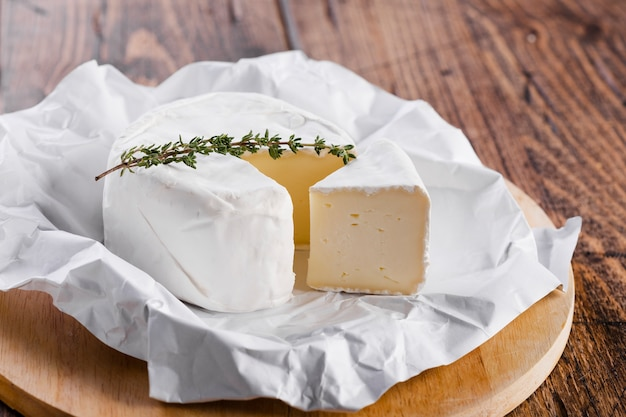 High view piece of cheese with knife Free Photo
