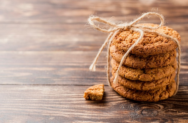 High view pile of biscuits with string Free Photo