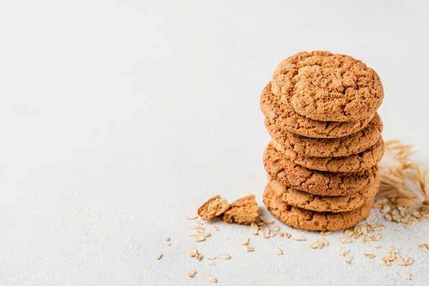 High view pile of cookies on white copy space background Free Photo