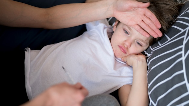 High view sick child with fever Premium Photo