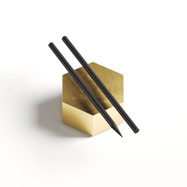 Высокий вид два карандаша на золотой геометрической форме Бесплатные Фотографии