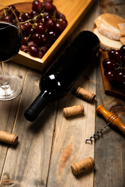 High view wine bottle on wooden table Free Photo