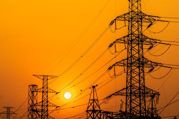 High voltage steel transmission tower during sunset Premium Photo