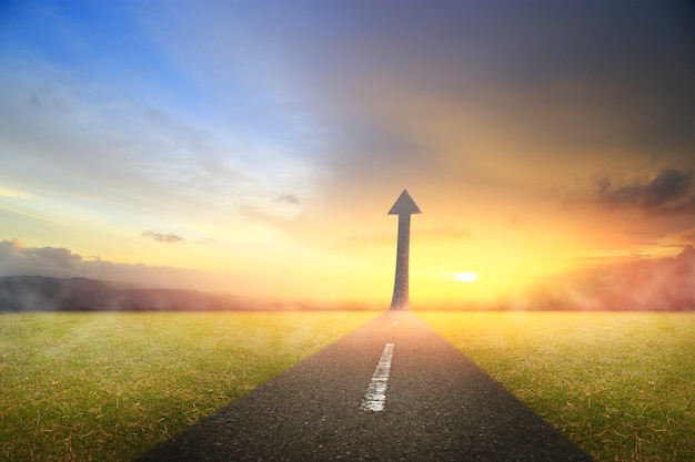 Highway road going up as an arrow for success Premium Photo