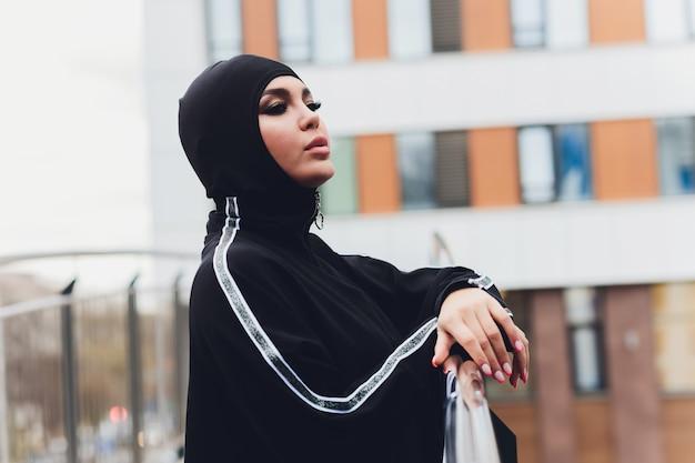 Hijab woman on walkway bridge in early morning Premium Photo