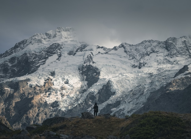 Hiker in front of a snowy mountain Premium Photo