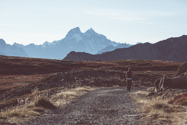 Hiker in high altitude rocky mountain landscape. summer adventures on the italian french alps, Premium Photo