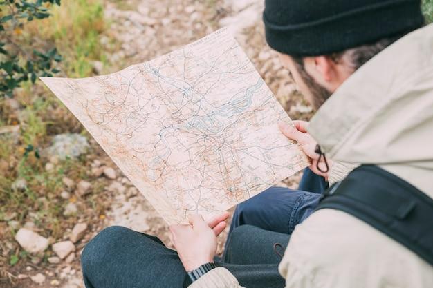 Hiker looking at map Free Photo