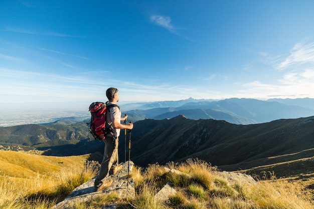 Hiker resting on the mountain top Premium Photo