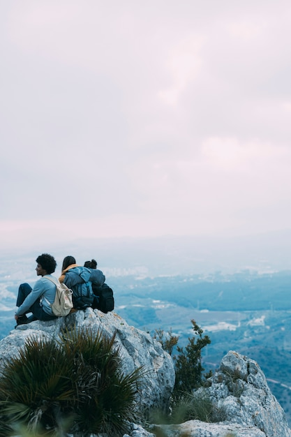 Hikers sitting on rock Free Photo