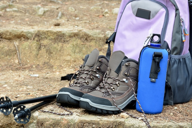 Hiking boots and backpack positions in nature Premium Photo