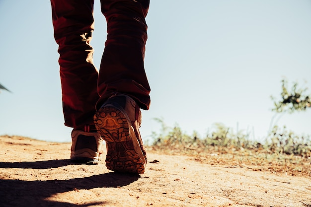 Hiking shoes in action on a mountain desert trail path. Free Photo