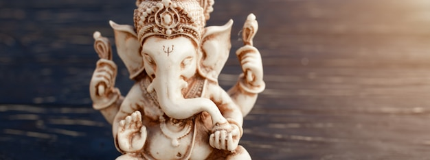 Hindu god ganesh on black Premium Photo