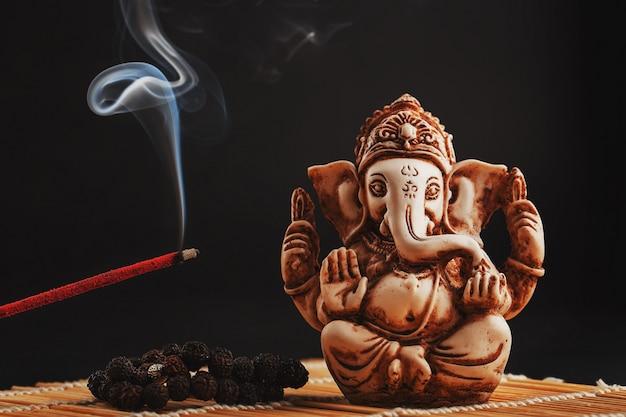 Hindu god ganesh on black Premium Photo