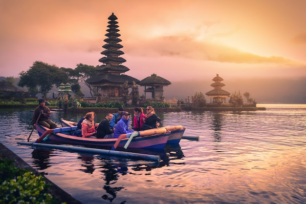Hindu temple on bratan lake landscape at sunrise in bali, indonesia Premium Photo