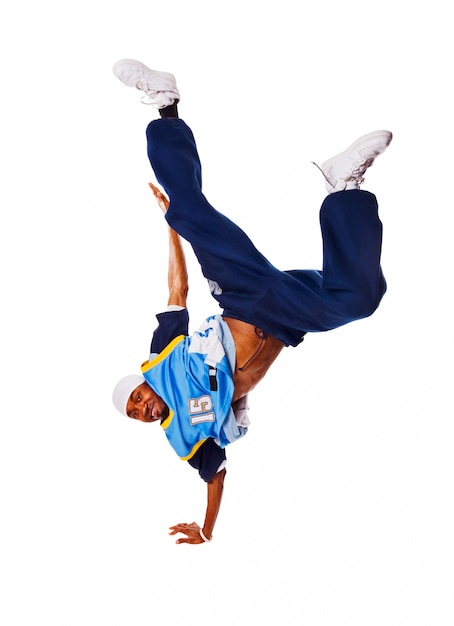 Hip-hop young man making cool move on white background Free Photo